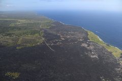 Helicopter aerial view of lava field by the ocean, Big Island, Hawaii.  Royalty Free Stock Images