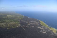Helicopter aerial view of lava field by the ocean, Big Island, Hawaii.  Stock Images