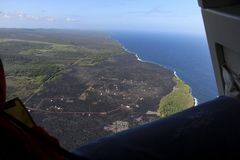 Helicopter aerial view of lava field by the ocean, Big Island, Hawaii.  Royalty Free Stock Photos