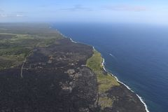 Helicopter aerial view of lava field by the ocean, Big Island, Hawaii.  Stock Image
