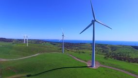 Helicopter aerial view of Wind Farm stock footage