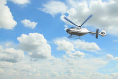 Helicopter against overcast sky Royalty Free Stock Photo