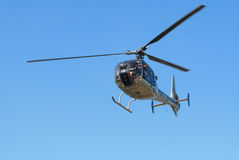Helicopter in the air. Blue sky Stock Image