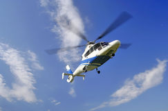 Helicopter in the air. Isolated on blue sky Royalty Free Stock Photo