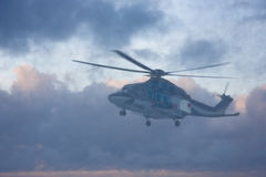 Helicopter in the air at bad weather Royalty Free Stock Photos