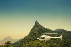 Helicopter in air in front of Corcovado. Sightseeing helicopter in front of Corcovado and the statue of Christ Stock Photography