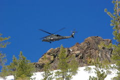 Helicopter Air Rescue. Air rescue by helicopter in the mountains at high altitude Royalty Free Stock Photo