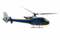 Helicopter airborne close-up. Civil helicopter hovering ready to climb and cruise Stock Photo