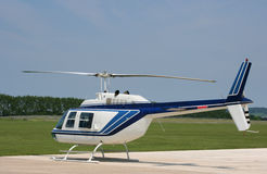 Helicopter at airfield. Private passenger helicopter at an airfield Stock Photo