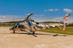 Helicopter on an airfield. Military helicopter on an air field Royalty Free Stock Images