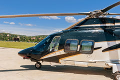 Helicopter on  an airfield. Helicopter parked on an airfield Stock Image