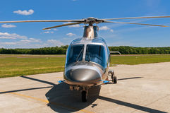 Helicopter on  an airfield. Helicopter parked on an airfield Stock Photos