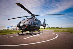 The helicopter in airfield Stock Photos