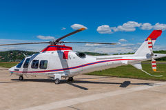 Helicopter on an airfield. White helicopter on an airfield Stock Photo