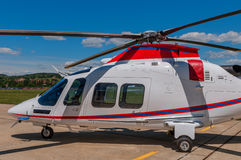 Helicopter on  an airfield. White helicopter on an airfield Royalty Free Stock Image