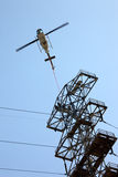 Helicopter Airlifting Workmen from Power Line Stock Images