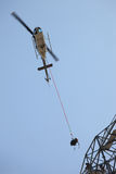 Helicopter Airlifting Workmen from Power Line royalty free stock images