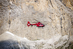 Helicopter in the alps stock image