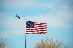 Helicopter and American Flag Stock Photography