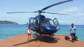 Helicopter arrival. Scenic private helicopter arrival on island Stock Photo