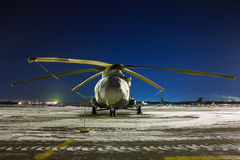 Helicopter asleep at night apron. Helicopter asleep at night winter apron royalty free stock image