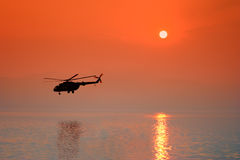 Helicopter At Sunset Stock Photos