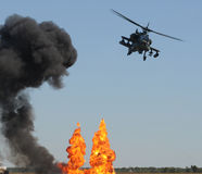 Helicopter attack. Modern US Army helicopter in aerial attack and bombardment Royalty Free Stock Images