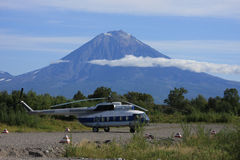 Helicopter at basement of volcano Stock Photo