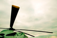 Helicopter Blades at Rest. A military helicopted captured at rest on a helipad. Camera used was a Nikon D70S with a 18-70mm lens set at 1/500 sec at f/13, with Stock Image