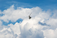 Helicopter in the blue sky Stock Photo