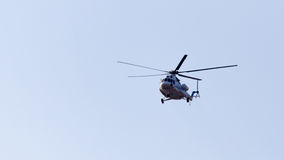 Helicopter on a blue sky Stock Image