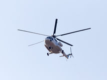 Helicopter on a blue sky Stock Photography