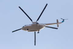 Helicopter on a blue sky Stock Photos
