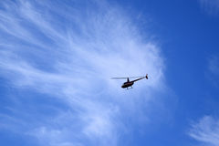 Helicopter in a blue sky Stock Photography