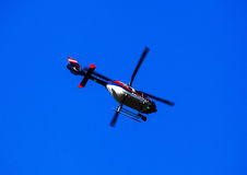 Helicopter on blue sky Stock Photos