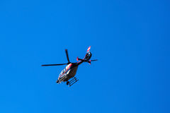 Helicopter on blue sky Stock Photo