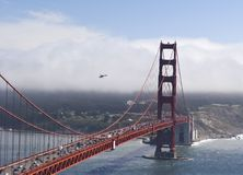 Helicopter Bridge. A helicopter passes over the Golden Gate Bridge Royalty Free Stock Photo
