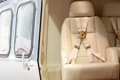 Helicopter business class interior. With chairs seat belts Stock Photography