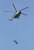 Helicopter and car. Helicopter is lifted by a car Stock Photo
