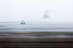 Helicopter car fog mist Royalty Free Stock Images