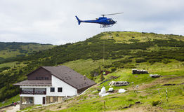 Helicopter and cargo. For hut on mountain, Romania Stock Photo