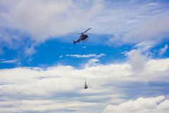 Helicopter carry cargo Stock Images