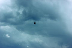 Helicopter (chopper) flyibg in bad weather Royalty Free Stock Photos
