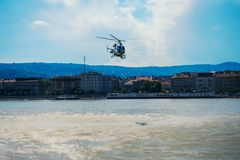 Helicopter is circling over the water in budapest. A helicopter is circling over the water in budapest stock photos