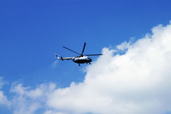 Helicopter. Civil Helicopter in Cloudy Skies stock photography