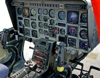 Helicopter cockpit. Instrumentation and navigational dashboard inside a modern helicopter Royalty Free Stock Images