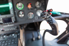 Helicopter cockpit. A helicopter cockpit with the control stick in the foreground and the instruments in the background Stock Images
