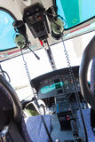 Helicopter cockpit. A helicopter cockpit with the control stick in the foreground and the instruments in the background Stock Photo