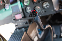 Helicopter cockpit. A helicopter cockpit with the control stick in the foreground and the instruments in the background Stock Image