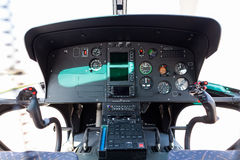 Helicopter cockpit. A helicopter cockpit with the control stick in the foreground and the instruments in the background Stock Photography